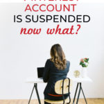 "woman sitting at desk. Text overlay ""My Pinterest Account is Suspended. Now What?"""
