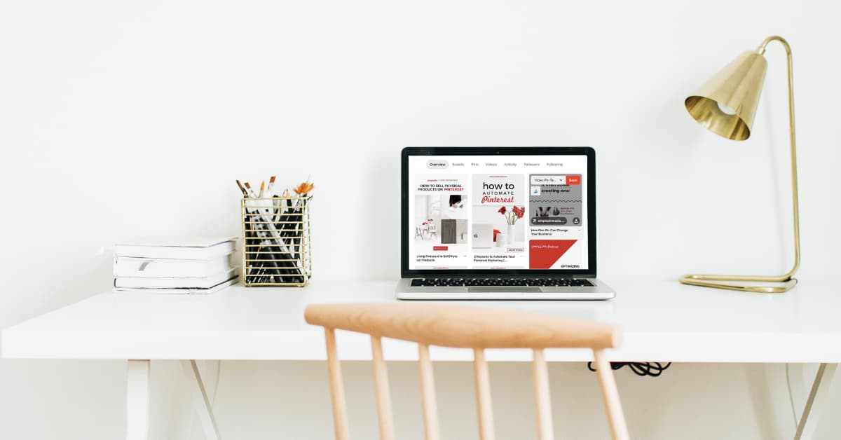 workstation with laptop displaying Pinterest app.